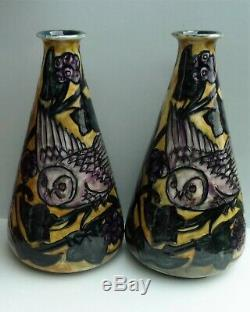 A fine pair of George Cartlidge Morris Ware Arts & Crafts owl vases. C. 1918